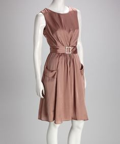 The waist-cinching, rhinestone-embellished sash on this stunning dress flatters the figure, while the deep front pockets and soft pleats drape feminine frames in elegance. A concealed zipper down the left side ensures a fitted look.Includes dress and beltMeasurements (size 6): 36'' chest (measured 1'' below arm); 32'' long from high point of shoulder to hem100% polyesterMachine wash; hang dryImported