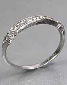 http://www.antiquejewelryforsale.com/viewProduct-966-18K_WHITE_GOLD_DECO_DIAMOND_BAND.html