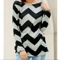 """❣LAST ONE❣ Chevron Long Sleeve Top Gray & Black Cozy lightweight chevron tunic in black & gray. Slight gathering at hips for flattering fit. Great paired with leggings, skinnies or shorts.  Size M/L 36"""" chest 27"""" length mid shoulder to hem.  NWOT Gamiss Tops Tunics"""
