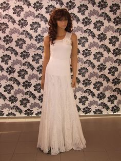 http://laiminga.hubpages.com/hub/Crochet-lace-and-knitted-wedding-dresses