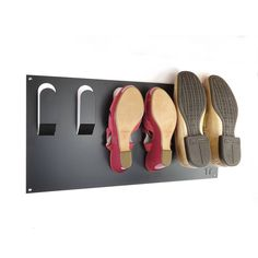 stylish wall mounted shoe rack by the metal house | notonthehighstreet.com