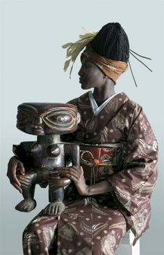 """WAfrica-Ankara Japanese kimonos by Cameroonian designer Serge Mouangue The name WAfrica is a combination of the word for Japanese spirit, """"wa,"""" and Africa. """"In I experimented with Japanese. Afro, African Fabric, African Art, African Style, African Prints, African Textiles, African Women, Geisha, Mode Wax"""