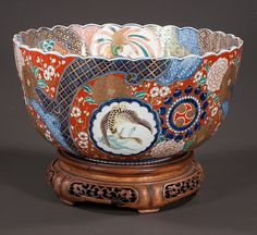 Fine Imari porcelain bowl with cobalt blue, gold and green, bird, animal and floral decorations, c.1860.