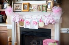 Decorate with adorable tiny baby clothes? Yes please!
