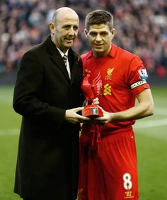 Gary McAllister presents Steven Gerrard with a special award to mark his 600th appearance