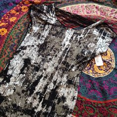 Brand new silky top Brand new top. Silky and very comfortable. Size XS but definitely can fit a Small as well. Rock & Republic Tops
