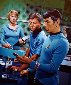 Chapel, McCoy, and Spock busy working in the lab