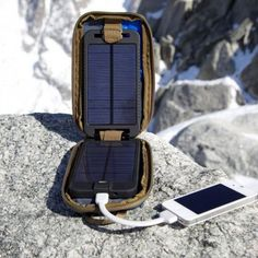 Solarmonkey charger with a tough water- and shock-resistant clam-shell case, attaches to your backpack hitting the trail. Unlike other solar chargers, it includes an internal battery that, when fully charged, can charge a smartphone two to three times. It takes about 8 hours to get a full charge and comes with a variety of adapters for all your gadgets. It retails for $132.