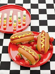 To make stoplights, slice mozzarella sticks in half lengthwise, then add circles of green, yellow, and red peppers. (A straw works well to punch out the circles.) For cars, push 4-inch skewers through the ends of hot dog buns and thread on wheels made from cucumber slices and cherry tomatoes.