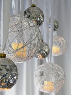 DIY Christmas ornament. Wrap white or sparkle yarn coated with Elmer's glue watered down around an inflated round balloon . Let dry, deflate balloon and insert flame less candle. Tie with satin ribbon.