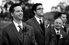 Photojournalistic Wedding Photography - Groom watching his bride walk down the aisle while dad looks at his son.