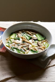 Soba noodles are made out of buckwheat, and offer a different taste than ordinary pasta. Miso is a popular soup in Japan, and has many reported health benefits. By using leeks and shiitake mushrooms you're making a soup that is much different than most of the other soups out there. Eclectic and healthy.
