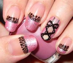 Very lacy, girly. Sparkly Pink & Black corset nail art.