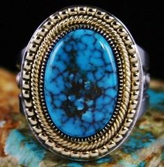 This type of turquoise is widely recognized as one of the most rare and beautiful types in the world. The marvelous stone is deep Candelaria blue with fine reddish-brown spiderweb in layers. A brilliant combination of chiseled bezel, twist wire and droplets all made from solid 18 Karat gold is the perfect compliment to the quality of the cabochon. | eBay!