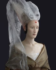 Suzanne Jongmans's work shows how to re-use packaging material to create fashionable items and beautifull photographs.