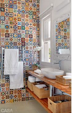 I like the old tiles on one wall idea, maybe we can do so for the downstair…