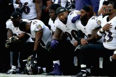 In apparent rebuke to Trump NFL players kneel during national anthem  Baltimore Ravens 0367d903f