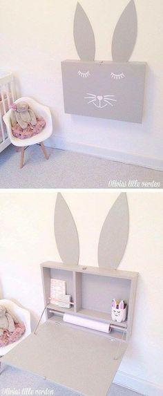 Une chouette table à langer en forme de tête de lapin