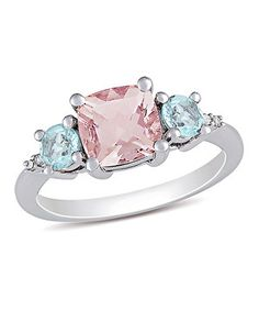 When this ring dons the hand, eyes can't help but be enchanted. A sparkling morganite gem and pretty twinkling topaz catch the light and compliments with ease.
