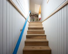Nice handrail.  Modern Bungalow Addition with Pops of Blue by The Practice of Everyday Design