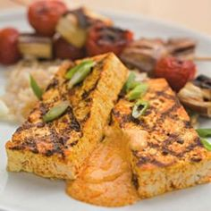 You've never had tofu like this before. @EatingWell's Tandori Tofu is coated with a tandoori-inspired spice rub and grilled to toothy perfection and topped with a creamy sauce. A delicious #vegetarian dinner! (Sub Non-dairy soy yogurt)