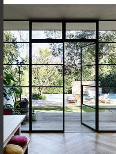 """The wall of black-steel-framed windows and doors is something Rachel was very particular about. """"The doors were custom-made in Melbourne, brought up on a truck and installed over a few days. Two things I refused to compromise on were the windows and floor Steel Windows, Windows And Doors, Wall Of Windows, Iron Windows, Timber Windows, Modern Windows, Bedroom Windows, Big Windows, Floor To Ceiling Windows"""
