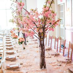 Tall Pink Centerpieces // Zev Fisher Photography // Centerpieces: Crimson Petal-Teleflora // http://www.theknot.com/weddings/album/a-simple-and-romantic-wedding-in-boston-ma-143826