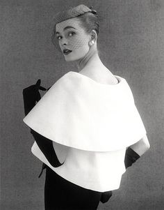 Susan Abraham in a John Cavanagh in a tiered evening dress. Photo by John French, London, 1954.