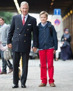 King Philippe of Belgium arrives with his oldest son Prince Gabriel for the first day of school at the Sint-Jan-Berchmans college in Brussels on September 1, 2015