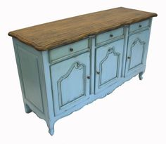 French rustic furniture teal blue sideboard. A deeper shade of aqua in modern high gloss and modern pulls will update this piece. The scalloped top and apron read as feminine French country, but the raw wood and deeper blue would add the masculine balance.