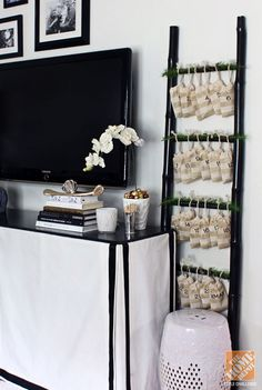 Image from http://ext.homedepot.com/community/blog/wp-content/wpuploads/Hunted-Interior-Black-White-Gold-Living-Room-10.jpg.