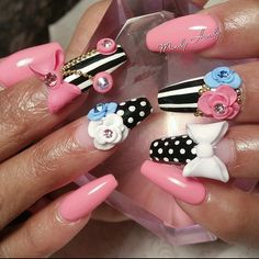 Glam Life.... #hotnailart #mindyhardy #nails #orlandonails #salonspa #idrive #atlantanails #atlnails #disneyworld #dopenails #cutenails #inmnails #acrylic #3dnails #3dflower #nailcharms #nailcouture #notd