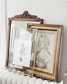 Pencil sketches in simple gold frames.