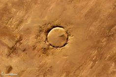 Deep in the Sahara Desert lies a meteor impact crater that is nearly a perfect circle. Tenoumer Crater is 1.9 kilometers wide, and sports a rim 100 meters high. It sits in a vast plain of rocks so ancient they were deposited hundreds of millions of years before the first dinosaurs walked the Earth.