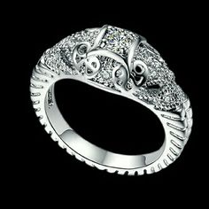 New Vintage Antique Style 0.25 ct Elephant CZ Ring Beautiful 18k White Gold Rhodium Finish Vintage Antique Style 0.25 ct Two Carved Hollow Elephant CZ Ring.  Main Stone: 4mm 0.25 ct Heart and Arrow Swiss Cz Setting: Pave Weight: 5.3g  ~Comes with Velvet Pouch~ Jewelry Rings
