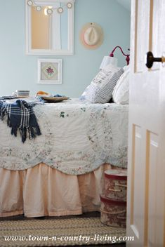 Our charming farmhouse bedroom is small on size but big on cottage style. A ruffled skirt paired with a wedding ring quilt create an inviting sleep zone.