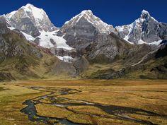 Yerupaja and Jirishanca behind a field and stream while on the Huayhuash Trek in Peru.