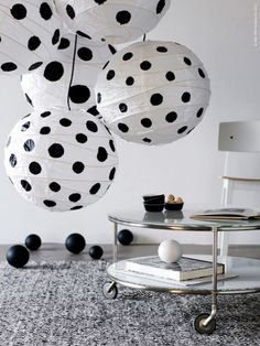 Painted black dots on the white globe lights.