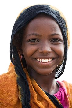 Indigenous Afar girl from Ethiopia. A simple.rural girl with a glorious face and a wonderful smile.