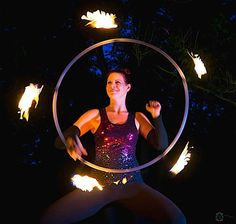 Tiffany Starr burns it up! She's fire hooping at the Cambridge Music Festival in Cambridge, Vermont. Photo by Vermont Artistry Photography.