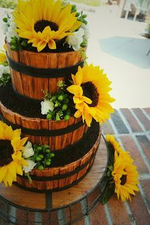 Believe it or not, this is a wedding cake sugar sculpted to look like a barrel, decorated with sunflowers.