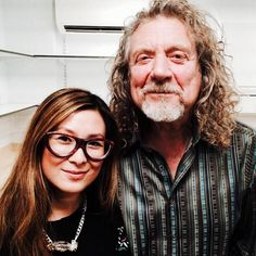 Robert Plant photographed with a fan July 21, 2014 in London