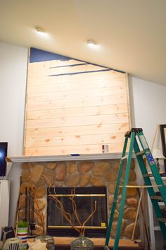 feature wall with shiplap and navy blue paint on fireplace