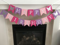 "**Please read footnotes regarding shipping and processing before ordering**  This Butterfly themed Happy Birthday banner with white shimmer letters is the perfect addition for any birthday party! It is handmade from high quality, acid free card stock. Each flag is 4.5"" wide x 5.5"" tall with 2.5"" white shimmer letters and the ends of each banner have a silver sparkle butterfly.  Colors used- Raspberry, Lavender and Baby Pink  Hangs on white satin ribbon. Each word hangs on its own piece of…"