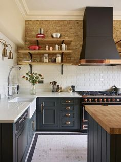 This kitchen has an industrial country feel to it and I love the exposed brick wall with the open shelving, dark grey units and hint of copper. #kitchenshelving