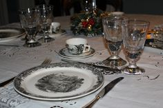 """early 800 Sicilian embroidery """"fillet"""" table cloth, wine and water hand made glasses, and lilac and gold Marsala wine glasses. Early 900 silver cutlery and hunting design plates (villeroy & boch)"""