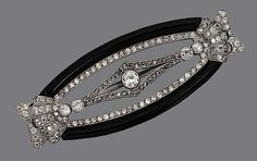 ONYX AND DIAMOND BROOCH The openwork oval motif set with 110 round and old European-cut diamonds weighing approximately 1.75 carats, further enhanced with two curved segments of onyx, mounted in platinum