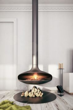 """42 Lovely Scandinavian Fireplace To Rock This Year. A stone fireplace design your pioneer ancestors would envy is the """"Multifunctional Fireplace."""" The hearth is built up high to create a storage a. Suspended Fireplace, Hanging Fireplace, Stove Fireplace, Fireplace Wall, Fireplace Design, Fireplace Ideas, Freestanding Fireplace, Floating Fireplace, Scandinavian Fireplace"""