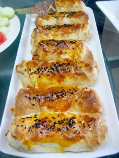 soooooo good :))))  BOREK WITH POTATO FILLING       Makes 14 boreks.       Ingredients:   •Turkish triangular fillo   •3 large size of potatoes  •1 small size onion (chopped )   •2 tbsp of tomato paste  •1/3 bunch of parsley  •1/2 cup vegetable oil  •1/2 tsp of ground black pepper  •salt    Topping:   •1 egg yolk  •nigella seeds  •1 cup of milk