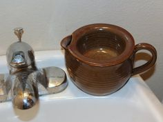 shaving cream scuttle - this one only keeps the soap warm no spot for the brush but in soap